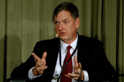 Fed's Evans says voted against rate hike over inflation concerns