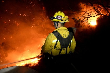 Diminished winds help California battle historic wildfire