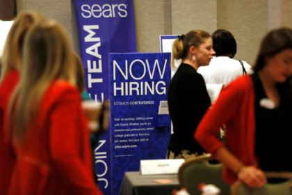U.S. private payrolls growth accelerates; jobless claims up