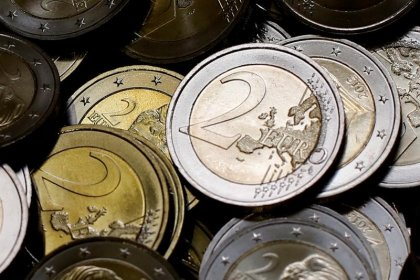 Global economic upturn boosts euro zone investor mood in January - survey