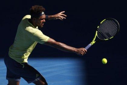 Tennis: Tsonga edges Shapovalov to strike blow for old guard