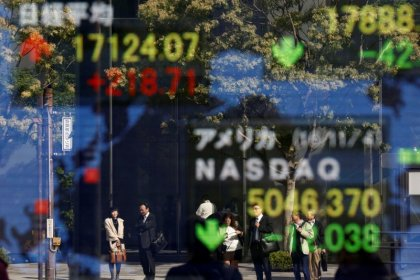Asia stocks touch record highs after Wall St. surge, dollar edges back