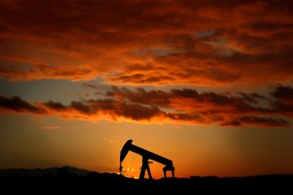 Oil up on threats of rebel attacks in Nigeria, falling US crude stocks
