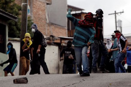 Honduran security forces battle protesters as election chaos lingers