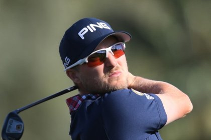 Golf: Cook fires up with 64 for one-stroke lead after three rounds