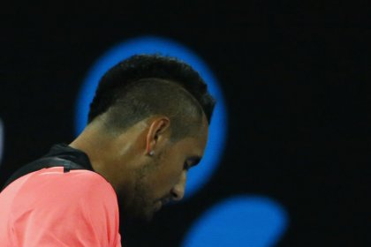Tennis: Kyrgios bows out defeated but wins over Australia