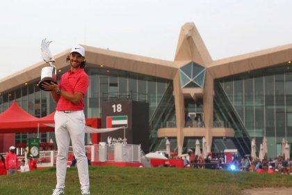 Fleetwood fires on back-nine to defend Abu Dhabi title