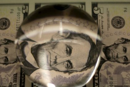 Dollar wallows near three-year lows on U.S. government shutdown