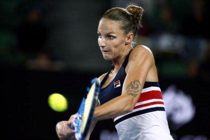Pliskova battles back to reach quarter-finals