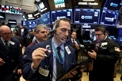 Wall Street edges up on energy bump; Facebook slide continues