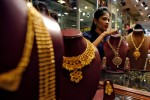 In India, digital gold sellers hope trickle will become a rush