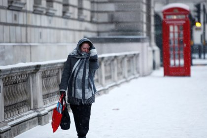 UK consumers cut spending as snow adds to inflation squeeze: Visa