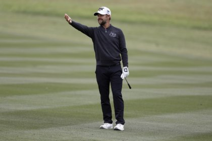 Golf: Johnson surges into share of lead in San Antonio