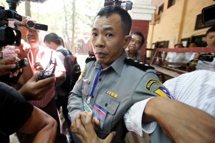 Family of Myanmar policeman who described sting on Reuters reporters evicted - family
