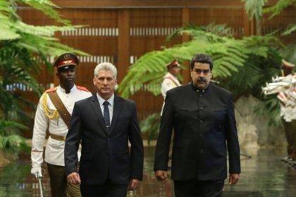 Underlining alliance, Venezuela's Maduro visits new Cuban leader