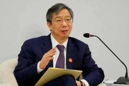 Chinese central bank governor says economy strong, financial leverage under control