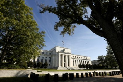 Fed leaves interest rates unchanged, says inflation near goal