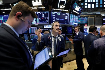 Wall Street dips but off earlier lows; Nasdaq flat