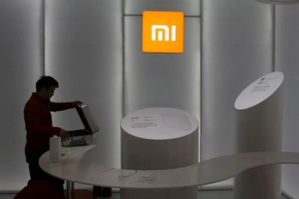 Exclusive: China's Xiaomi cuts valuation after pulling mainland offering: sources