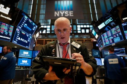 Trade fears slam stocks and commodities as investors eye safety
