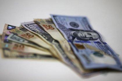 Dólar recua ante real com atuações do BC e exterior