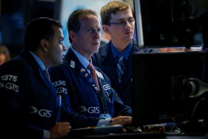 Dow snaps losing streak on energy lift
