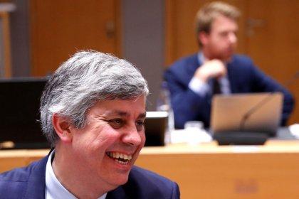 EU backs bigger war chest for failing banks but split on budget, debt