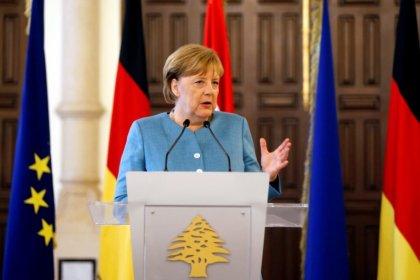 Merkel plays down chances of breakthrough in EU migration talks