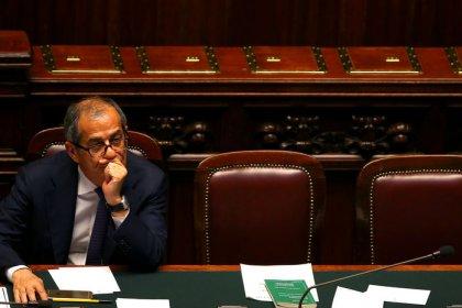 Italy finance minister mixes cautious, defiant tones on EU debut