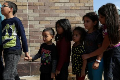 Parted at U.S. border by Trump policy, migrants seek their children
