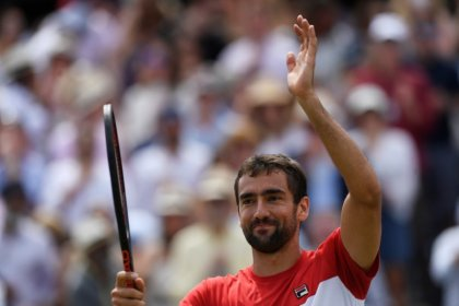 Cilic stays cool to edge Kyrgios in Queen's semi