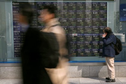 Asian shares slip on trade worries, oil gives up some gains