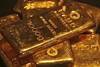 Цены на золото держатся у минимума 6-ти месяцев из-за сильного доллара