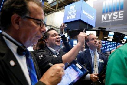 Wall Street ekes out gain as Nike surges
