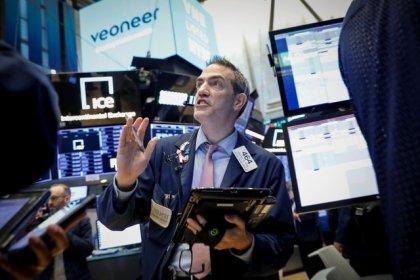 Global stocks edge lower as trade worries overshadow rising oil prices
