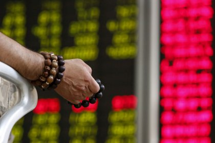 Asian shares fall on soft China data, trade war fears
