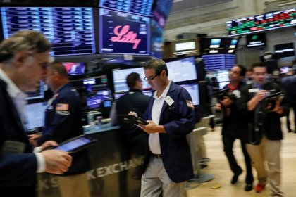 Wall Street opens flat as weak oil prices offset earnings enthusiasm