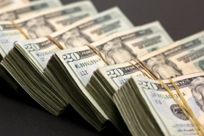 Dollar below one-year highs on Trump comments; yuan eyed
