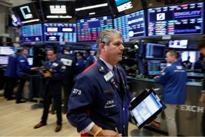Wall Street slips as trade worries dampen upbeat earnings