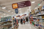 UK consumer spending dips in July, modest pay rises ahead