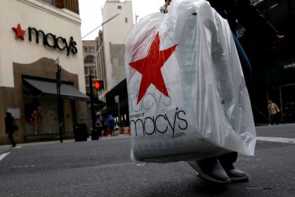 Macy's raises full-year forecast, investors lock gains