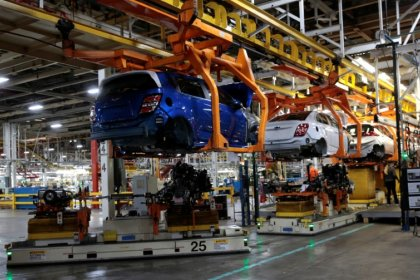 U.S. industrial output rises modestly, powered by factories