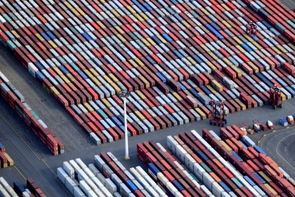 Euro zone June trade surplus falls by less than expected