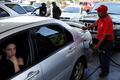 Venezuelans rush to shop, fill tanks before monetary overhaul