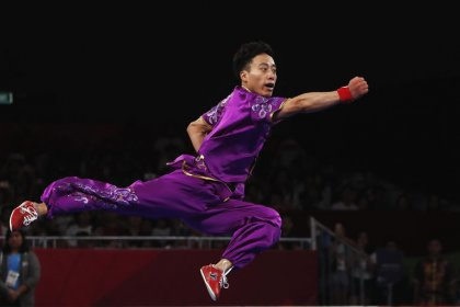 Sun shines with wushu gold to give China perfect Asiad start