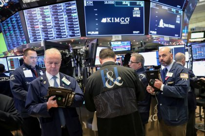 Wall St. ends choppy session higher; tech a boost