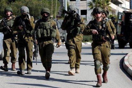 Israeli troops raid Palestinian news agency for footage
