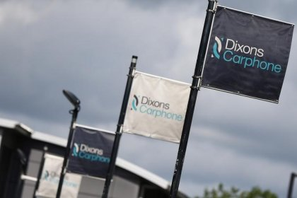 Dixons Carphone cuts dividend after profit slump