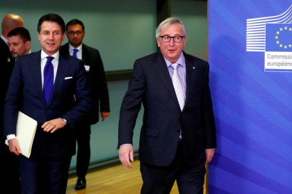 Italy lowers deficit target, EU sees progress on budget row
