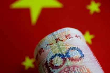 China central bank adviser says China should defend yuan at seven yuan per dollar